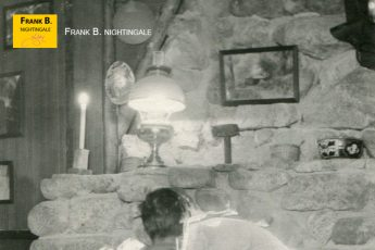 Frank at Wa-Wan cabin fireplace (~1916)